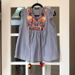 Embroidered top with poms